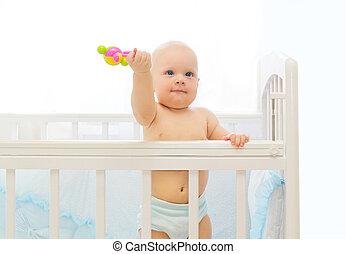 pequeno, cama brinquedo, bebê, lar, tocando