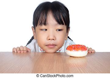 pequeno, chinês, donuts, olhar, menina asiática