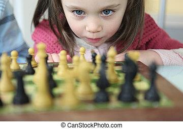 pequeno, xadrez, menina, tocando