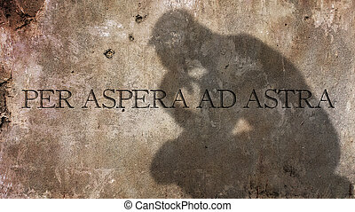 Per Aspera Ad Astra. A Latin phrase meaning Through hardships to the stars.