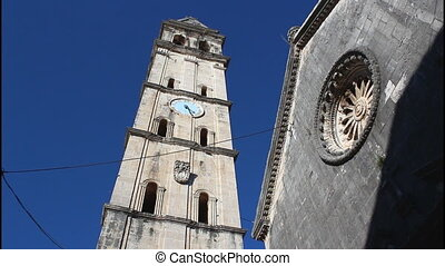 Perast, church and bell tower, pan right