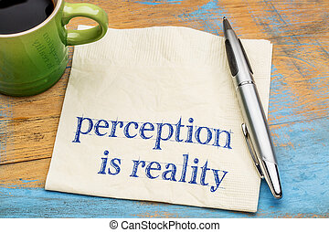 Perception is reality - handwriting on a napkin with a cup of espresso coffee