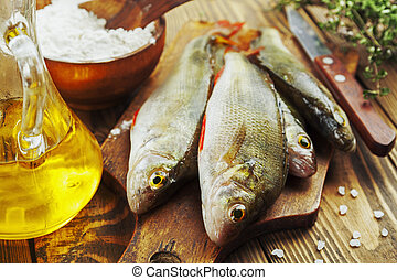 Perch, fish - Fresh fish perch on a wooden table