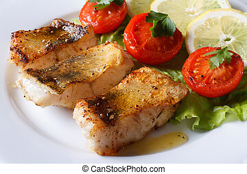 perch fried fillet with vegetables. Horizontal close-up -...