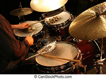 Percussion - A drummer at a concert with various percussion...