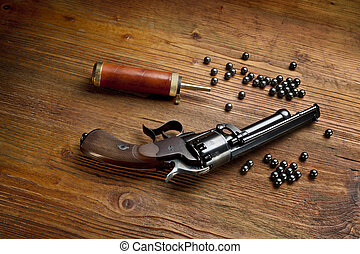 percussion pistol revolver on the wooden table still life...