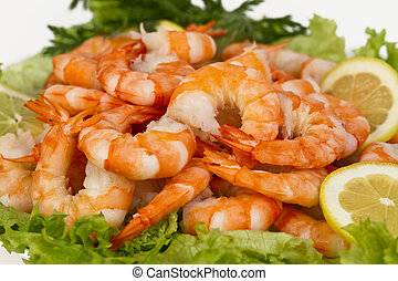 Perfect appetizer of boiled peeled shrimp with lemon and herbs