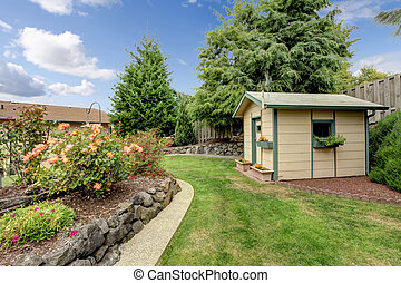 perfect back yard with garden, and shed.