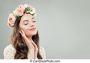 Perfect Beautiful Woman Portrait. Cheerful Female Model in Flowers on her Head