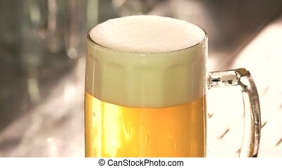 Perfect beer froth. Head of beer with perfect foam. Beer...