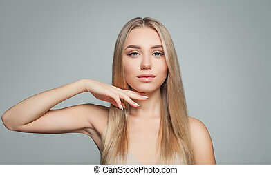 Perfect blonde woman with healthy skin and long straight hairstyle. Facial treatment, facial lifting and cosmetology concept