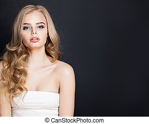 Perfect blonde woman with long hair on black background