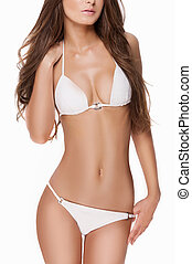 Perfect body. Cropped image of attractive young woman in...