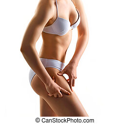 Perfect body of slim, fit and sporty woman in underwear isolated on white.