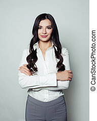Perfect business woman portrait. Beautiful young woman smiling