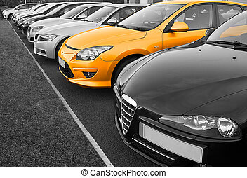 The perfect new car of your choice selected from a row of different european marques of used cars for retail sale on a motor dealers forecourt all logos removed
