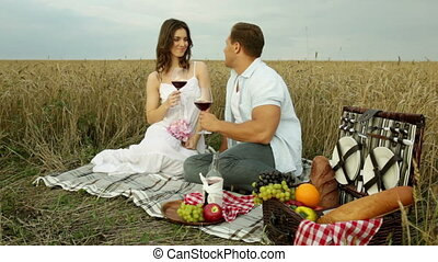 Perfect date - Lovely couple having a romantic picnic in the...