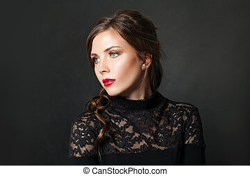 Perfect elegant woman with red lips makeup hair on black background