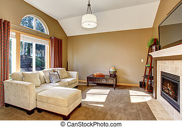Perfect family living room with carpet, and hanging light fixture.