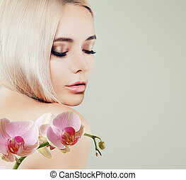 Perfect female face closeup. Young blonde woman with healthy skin and pink orchid flowers on banner background