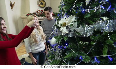 Perfect Fir-Tree - Family decorating a wonderful Christmas...