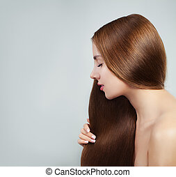 Perfect girl with straight healthy hair on white background. Beautiful woman portrait