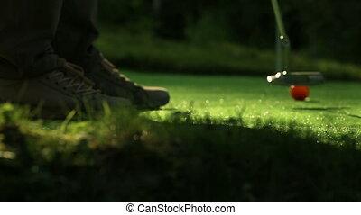Perfect golf putt. Three orange balls - Perfect golf putt....