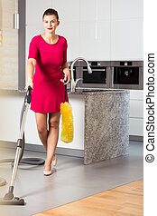 Perfect housewife with vacuum cleaner