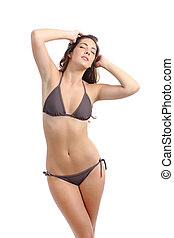 Perfect model woman fitness slim body posing wearing bikini