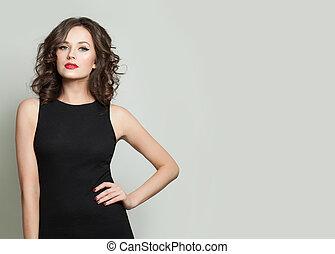 Perfect model woman in black dress portrait