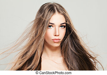 Perfect Model Woman with Blowing Hair. Young Woman with Long Healthy Hairstyle, Beauty Salon Background