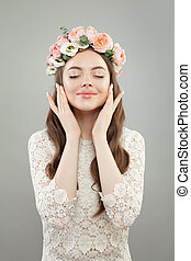 Perfect model woman with clear skin and flowers. Natural beauty