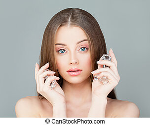 Perfect Model Woman with Ice Cubes. Sa Girl with Healthy Skin on Gray Background