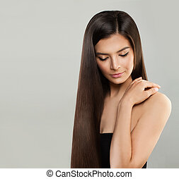 Perfect Model Woman with Long Healthy Hair on Gray Background, Haircare Concept
