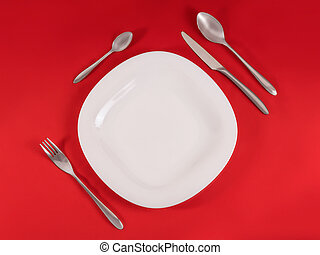 Perfect modern table setting on red napkin background