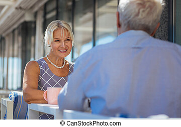 Delighted cheerful woman smiling to her husband