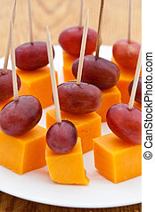 Perfect party snacks. Cheese cubes with red seedless grapes...