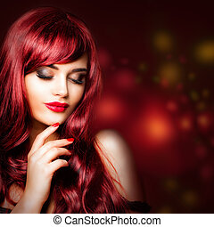 Perfect redhead woman portrait. Glamorous fashion model with makeup and long wavy hair on luxurious background