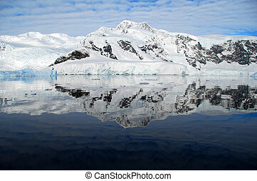 perfect reflection of antarctica in the ocean