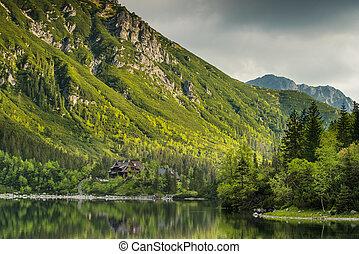 Perfect reflectionin alpine lake at early morning, Tatra, Poland