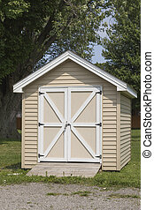 Perfect Shed - Cute little premade shed. Beige siding and...