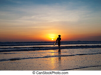 Perfect sunset for surfers in Bali