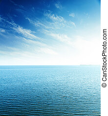 perfect sunset in blue sky over sea. aerial view