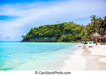 Perfect tropical beach with turquoise water and white sand beaches in Boracay, Philippines