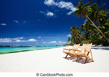 Perfect vacation - Beach chairs on perfect tropical white...