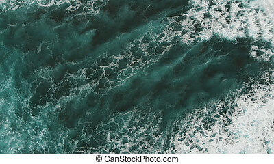 Perfect view of the stunningly beautiful surface of the Atlantic Ocean. Giant turquoise waves, west coast of Tenerife. Bird's eye view.