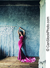 Perfect Woman in Fashion Dress Posing in Vintage Interior