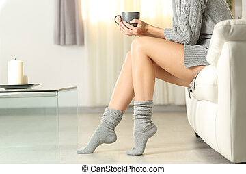 Perfect woman waxed legs in winter at home