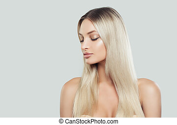 Perfect Woman with Fresh Skin and Long Healthy Blonde Hair. Facial treatment. Cosmetology, beauty, haircare and spa