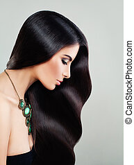 Perfect Woman with Long Healthy Hair and Makeup. Beautiful Girl, Hair Care and Beauty Salon Background